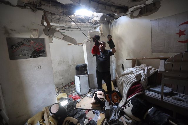 29 May 2021, Palestinian Territories, Gaza City: A Palestinian artist salvage his puppets from an art house destroyed previously by Israeli airstrikes  during the Israeli-Palestinian fighting. Israel and the Palestinian Islamist movement Hamas have so far