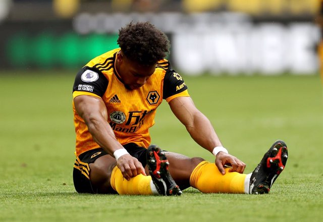 23 May 2021, United Kingdom, Wolverhampton: Wolverhampton Wanderers' Adama Traore sits injured on the pitch during the English Premier League soccer match between Wolverhampton Wanderers and Manchester United at the Molineux Stadium. Photo: Bradley Collye