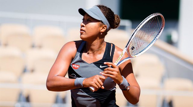 Naomi Osaka of Japan in action during the first round of the 2021 Roland Garros Grand Slam Tournament against Patricia Maria Tig of Romania