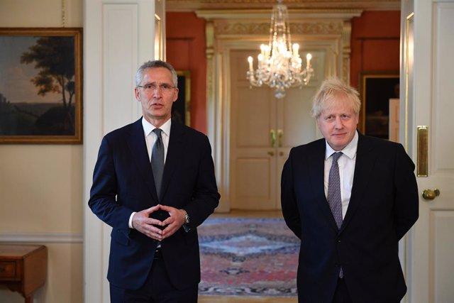 02 June 2021, United Kingdom, London: UK Prime Minister Boris Johnson (R) NATO Secretary General Jens Stoltenberg speak to the press after their meeting at 10 Downing Street. Photo: Justin Tallis/PA Wire/dpa