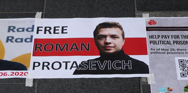"""29 May 2021, Ireland, Dublin: A sign with a portrait of the arrested Belarusian journalist Protasevich and the words """"Free Roman Protasevich"""" is pasted on the ground outside the General Post Office during a protest by members of the Belarusian community i"""