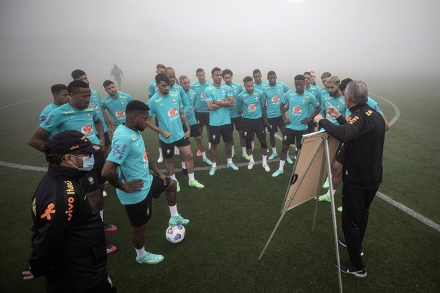HANDOUT - 30 May 2021, Brazil, Teresopolis: Brazil head coach Tite leads a training session for the Brazil National Soccer Team at the Granja Comary sports Complex where the team begins preparing for the upcoming 2021 Copa America which will take place in