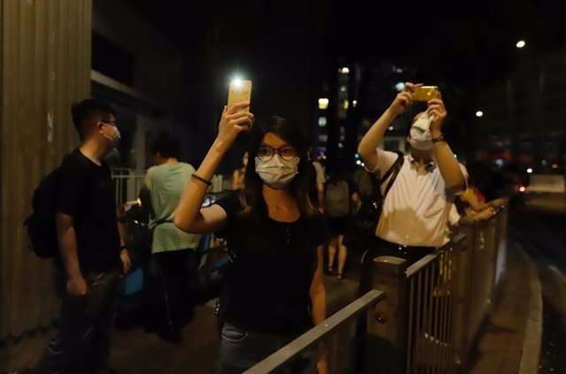 04 June 2021, China, Hong Kong: People take part in a vigil outside Victoria Park to markthe 32nd anniversary of China's 1989 Tiananmen Square massacre. The vigil got banned by the authorities due to the coronavirus pandemic. Photo: Liau Chung-Ren/ZUMA W