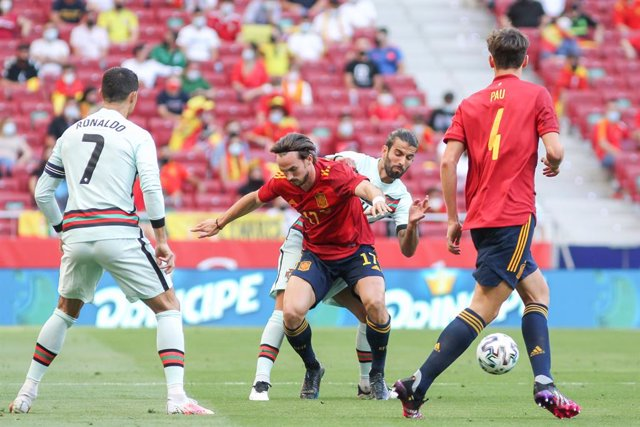Fabian Ruiz of Spain and Sergio Oliveira of Portugal in action during the international friendly match played between Spain and Portugal at Wanda Metropolitano stadium on Jun 04, 2021 in Madrid, Spain.