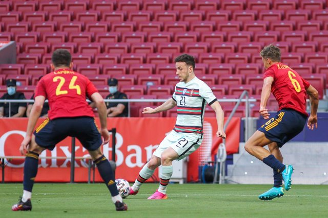 Aymeric Laporte of Spain, Diogo Jota of Portugal and Marcos Llorente of Spain in action during the international friendly match played between Spain and Portugal at Wanda Metropolitano stadium on Jun 04, 2021 in Madrid, Spain.