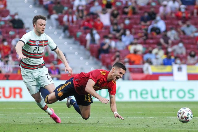 Diogo Jota of Portugal and Ferran Torres of Spain fight for the ball during the international friendly match played between Spain and Portugal at Wanda Metropolitano stadium on Jun 04, 2021 in Madrid, Spain.