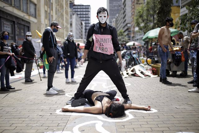 """04 June 2021, Colombia, Bogota: Activists take part in a performance to commemorate those illegally executed in Colombia. According to the judicial authority JEP, at least 6402 people were illegally executed between 2002 and 2008 and portrayed as rebels """""""