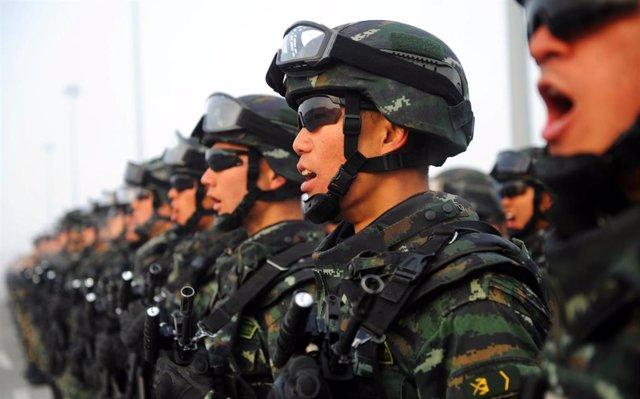 Archivo - Fuerza paramilitar para combatir a los uigures en China