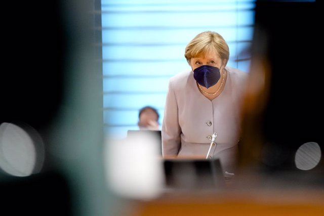 09 June 2021, Berlin: German Chancellor Angela Merkel arrives to attend the weekly cabinet meeting at the Chancellery. Photo: Markus Schreiber/AP POOL/dpa