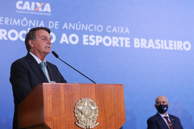 HANDOUT - 01 June 2021, Brazil, Brasilia: Brazilian President Jair Bolsonaro speaks during a ceremony of the state bank sponsoring Brazilian athletics as he also confirmed that his country will host the 2021 Copa America at the Planalto presidential palac