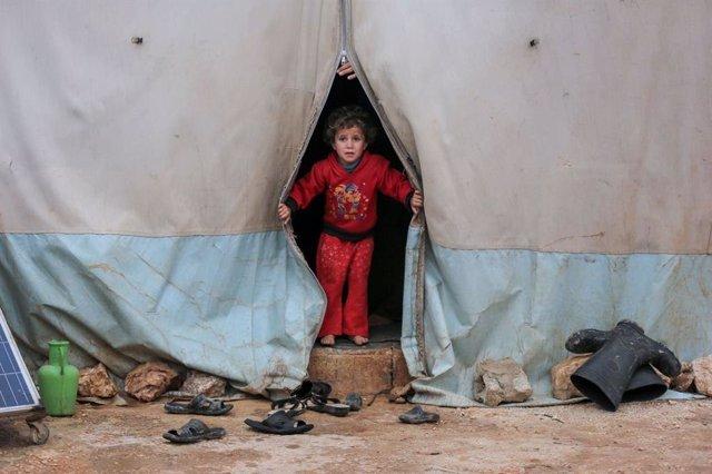 Archivo - Niño en campamento de refugiados en Siria