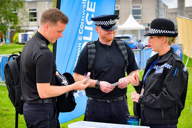 07 June 2021, United Kingdom, Devon: Police officers from external forces across the UK arrive and begin to be processed at Devon and Cornwall Police's tented briefing centre, before being deployed on policing duties for the G7 summit, which will be held
