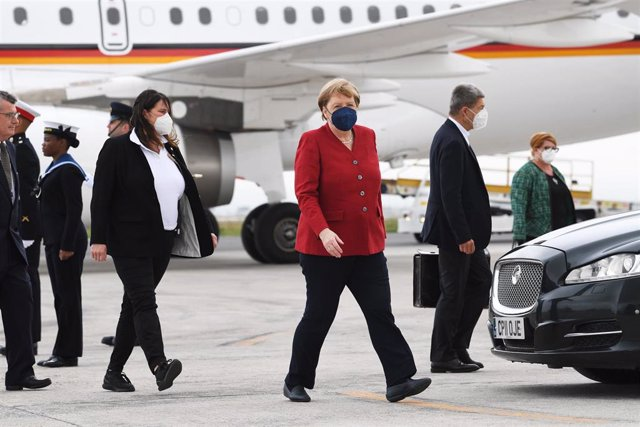 11 June 2021, United Kingdom, Newquay: German Chancellor Angela Merkel (C) arrives at Cornwall Airport Newquay to attend the G7 summit, that will be held from 11 to 13 June. Photo: Stefan Rousseau/PA Wire/dpa