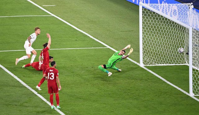 11 June 2021, Italy, Rome: Italy's Ciro Immobile (L) scores his side's seond goal past Turkey goalkeeper Ugurcan Cakir during the UEFA EURO 2020 Group Asoccer match between Italy and Turkey at the Olympic Stadium. Photo: Matthias Balk/dpa