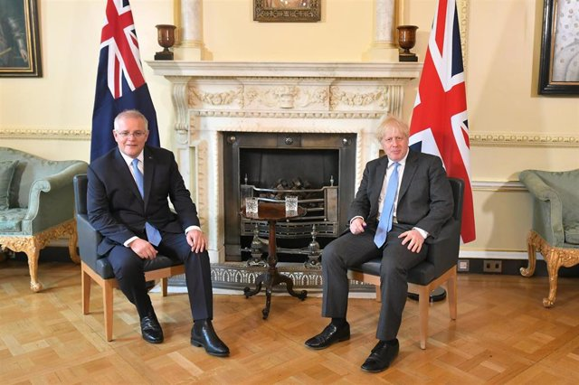 15 June 2021, United Kingdom, London: UK Prime Minister Boris Johnson (R) speaks with Australian Prime Minister Scott Morrison during their meeting to formally announce a joint trade deal at 10 Downing Street. It will be the UK's first trade deal negotiat