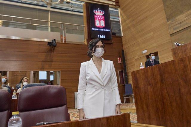 La presidenta en funciones de la Comunidad de Madrid, Isabel Díaz Ayuso, en la primera sesión del pleno de su investidura en la Asamblea de Madrid