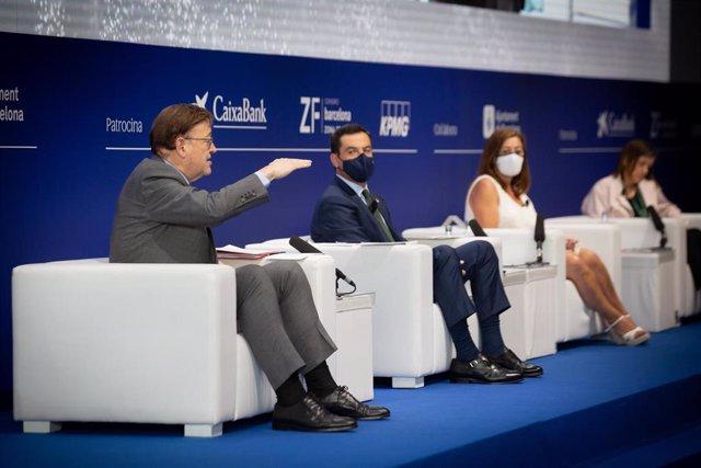 (I-D) El president de la Generalitat Valenciana, Ximo Puig; el president de la Junta d'Andalusia, Juanma Moreno i la presidenta de les Illes Balerares, Francina Armengol, intervenen en una sessió, sota el títol: `El model territorial per millorar la