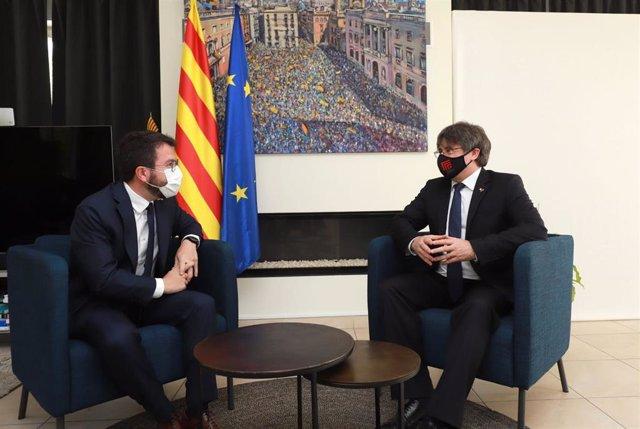 Reunión del presidente de la Generalitat, Pere Aragonès, con el expresidente Carles Puigdemont, el 18 de junio en Bélgica.