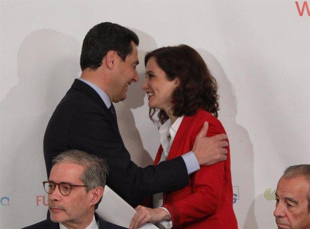 Archivo - Juanma Moreno e Isabel Díaz Ayuso, en una fotografía de archivo
