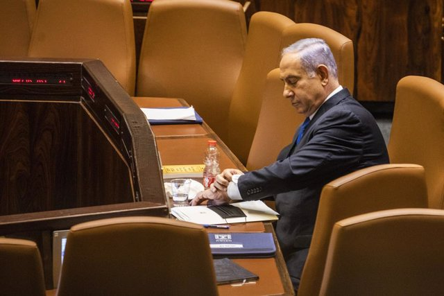 13 June 2021, Israel, Jerusalem: Israeli Prime Minister Benjamin Netanyahu attends a session at the Israeli Parliament (Knesset), which has convened to vote on the country's next government under Naftali Bennett, who is set to become Israel's new Prime Mi