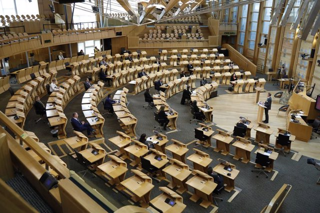 Archivo - HANDOUT - 10 May 2021, United Kingdom, Edinburgh: Newly-elected members of Parliament attend the Scottish Parliament session following the results of the election. Representatives who have been elected for the first time, or who are returning af