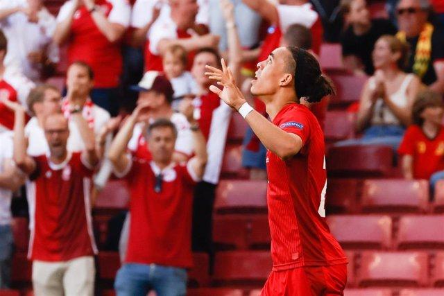 17 June 2021, Denmark, Copenhagen: Denmark's Yussuf Poulsen celebrates after scoring his side's first goal during the UEFA EURO 2020 Group B soccer match between Denmark and Belgium at Parken stadium. Photo: Bruno Fahy/BELGA/dpa