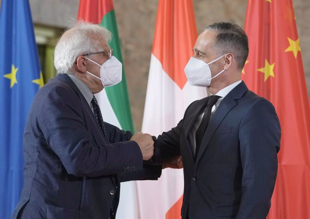 23 June 2021, Berlin: German Foreign Minister Heiko Maas (R) welcomes High Representative of the European Union for Foreign Affairs and Security Policy Josep Borrell at the Federal Foreign Office for the second Berlin Conference on Libya. Photo: Michael S