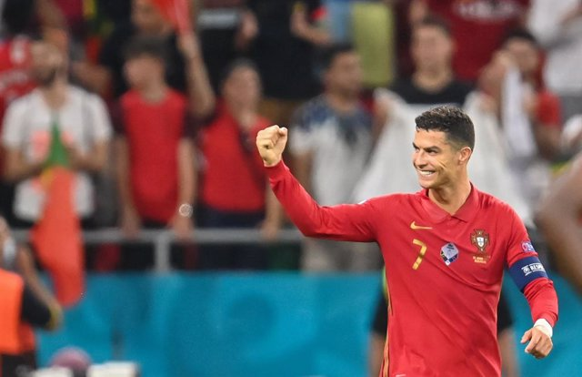 23 June 2021, Hungary, Budapest: Portugal's Cristiano Ronaldo celebrates scoring his side's first goal during the UEFA EURO 2020 Group F soccer match between Portugal and France at the Puskas Arena. Photo: Robert Michael/dpa-Zentralbild/dpa