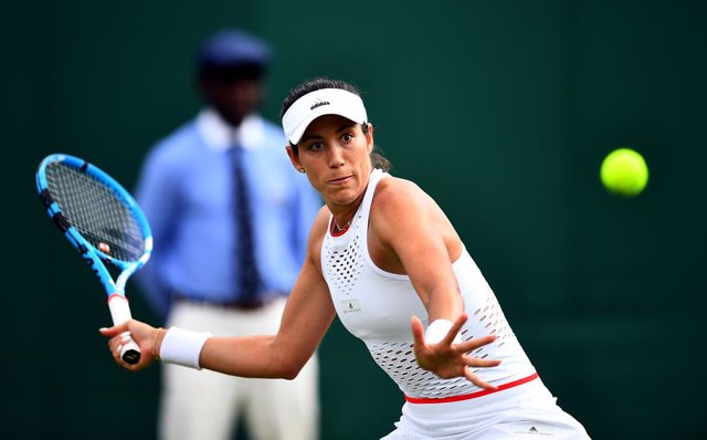 Archivo - 02 July 2019, England, London: Spanish tennis player Garbine Muguruza in action against Brazil's Pauline Parmentier during their women's singles round of 128 match on day two of the 2019 Wimbledon Grand Slam tennis tournament at the All England