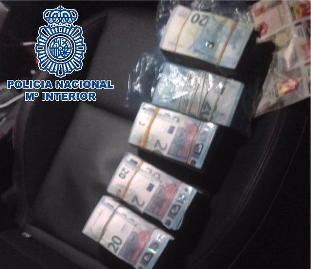 Dinero incautado por la Policía Nacional en una operación con 18 detenidos