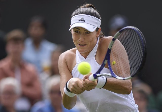 28 June 2021, United Kingdom, London: Spanish tennis player Garbine Muguruza in action against France's Fiona Ferro during their women's singles first round match on day one of the 2021 Wimbledon Tennis Championships at The All England Lawn Tennis and Cro