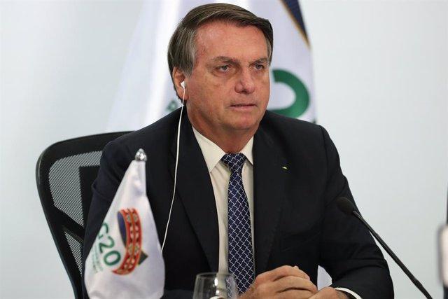 Archivo - HANDOUT - 22 November 2020, Brazil, Brasilia: Brazilian President Jair Bolsonaro attends a video conference from the Planalto Palace, on the second day of the virtual G20 summit, presided by Saudi Arabia. Photo: Marcos Corrêa/Brazilian Presidenc