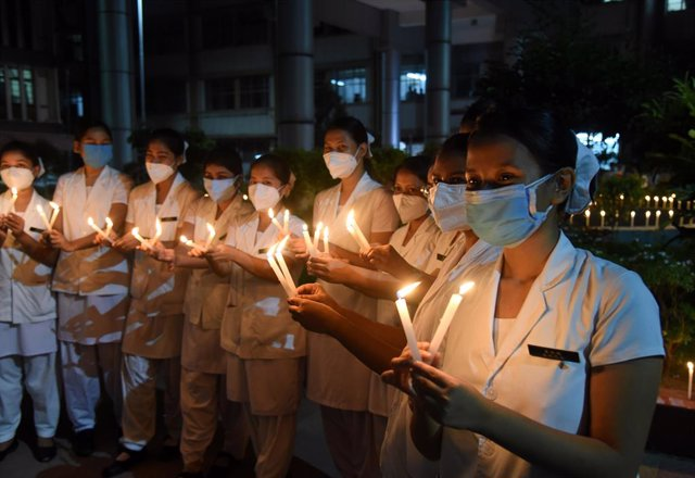 01 July 2021, India, Guwahati: Nurses attend a candlelight ceremony to pay a tribute to the doctors who died because of the coronavirus (COVID-19) on the occasion of the National Doctors' Day in India. Photo: Dasarath Deka/ZUMA Wire/dpa