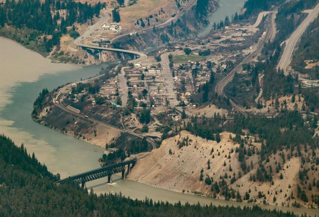 01 July 2021, Canada, Lytton: An aerial view shows the almost completely destroyed Canadian town of Lytton due to a wildfire. Photo: Darryl Dyck/The Canadian Press via ZUMA/dpa