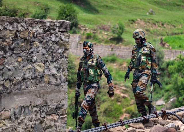 27 June 2021, India, Poonch: Indian army soldiers patrol near Line of Control (LoC) in Poonch. Photo: Nazim Ali Manhas/PTI/dpa