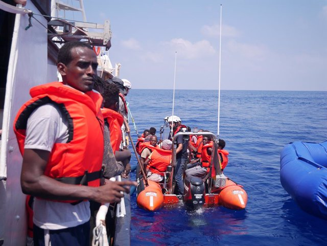 """Archivo - 26 August 2019, Libya, --: African migrants are pictured after they were rescued by the German aid ship """"Eleonore"""" at the Mediterranean Sea. Photo: Johannes Filous/dpa"""