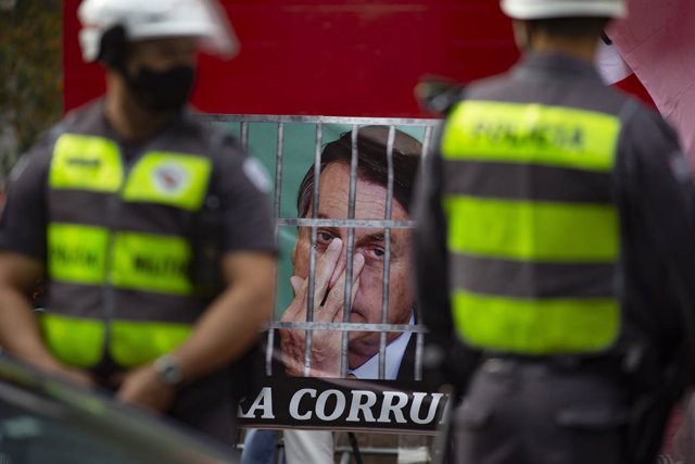 03 July 2021, Brazil, Sao Paulo: A banner with the photo of President Jair Bolsonaro in prison is seen during a protest on Paulista avenue against President Jair Bolsonaro's coronavirus policies after the Supreme Court allowed investigations to be opened