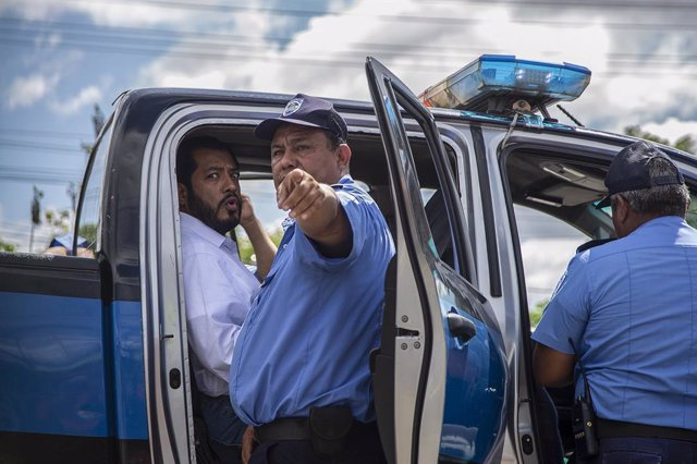 FILED - 22 June 2021, Nicaragua, Managua: Nicaraguan presidential candidate Felix Madariaga (L) is arrested by police as he tried to leave the capital. Five candidates for the presidential candidacy from opposition alliances were arrested within a few wee