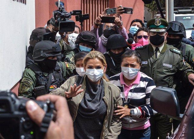 Archivo - 15 March 2021, Bolivia, La Paz: Jeanine Anez, Bolivia's former interim president, arrives at the Centro de Orientación Femenina de Obrajes detention centre to serve a four-month preventative detention. Anez was detained as part of investigations