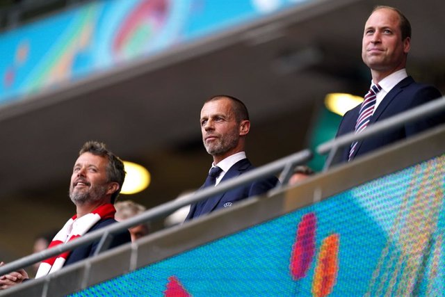 07 July 2021, United Kingdom, London: (L-R) The Crown Prince Frederik of Denmark, UEFA president Aleksander Ceferin and Prince William, Duke of Cambridge, sit in the stands during the UEFA Euro 2020 semi-final soccer match between England and Denmark at W