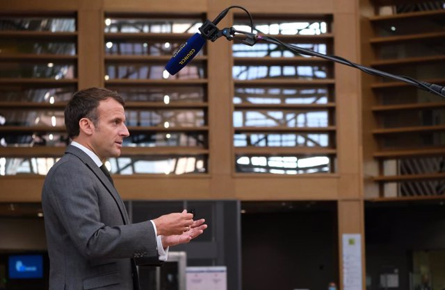 HANDOUT - 24 June 2021, Belgium, Brussels: French President Emmanuel Macron speaks to media as he arrives on the first day of a two-days European Union summit at the European Council. Photo: Alexandros Michailidis/European Council/dpa - ATTENTION: editori