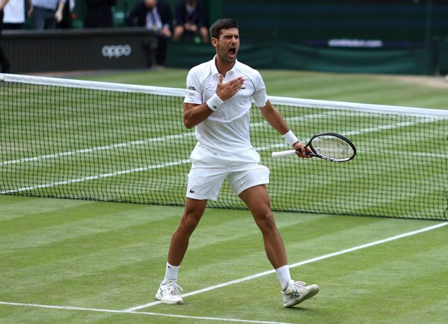 09 July 2021, United Kingdom, London: Serbian tennis player Novak Djokovic celebrates defeating Canadian Denis Shapovalov during their men's singles semi final match on day eleven of the 2021 Wimbledon Tennis Championships at The All England Lawn Tennis a
