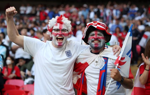 07 July 2021, United Kingdom, London: England fans show their support in the stands prior to the start of the UEFA Euro 2020 semi-final soccer match between England and Denmark at Wembley Stadium. Photo: Nick Potts/PA Wire/dpa