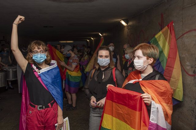 08 July 2021, Poland, Warsaw: Demonstrators hold placards and rainbow flags during a rally to show solidarity with the Georgian LGBT community next to the embassy of Georgia. Photo: Aleksander Kalka/ZUMA Wire/dpa