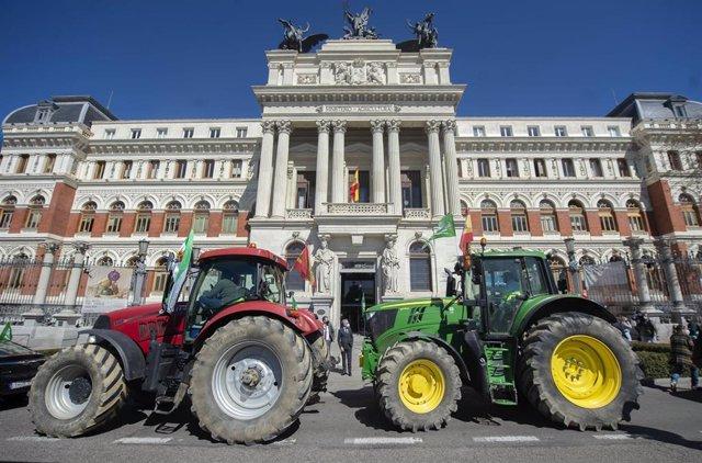 Archivo - Dos tractores, frente al Ministerio de Agricultura, donde representantes de agricultores han llegado para pedir mejoras para el campo, en Madrid (España), a 17 de marzo de 2021.