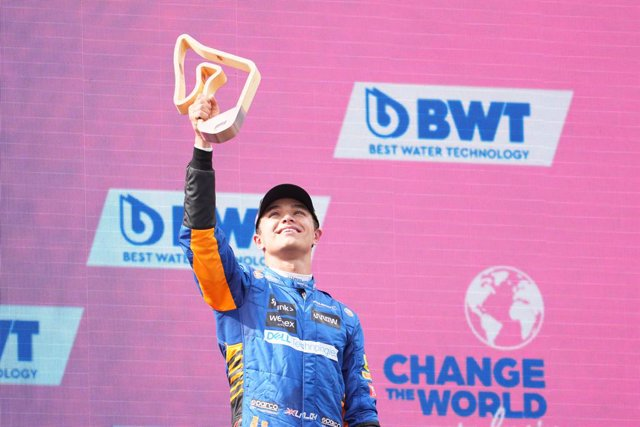 04 July 2021, Austria, Spielberg: McLaren's British driver Lando Norris celebrates his third place during the awards ceremony of the 2021 Formula One Grand Prix of Austria at the Red Bull Ring. Photo: Georg Hochmuth/APA/dpa