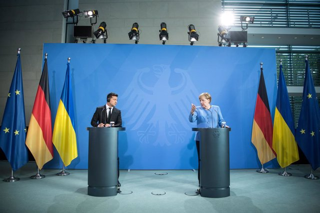 12 July 2021, Berlin: German Chancellor Angela Merkel (R) and Ukrainian President Volodymyr Zelensky give a press statement before their talks. Photo: Stefanie Loos/AFP POOL/dpa