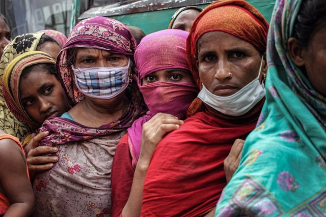 11 July 2021, Bangladesh, Dhaka: People wait in a queue while avoiding social distancing as they buy government subsidiary food during a lockdown in Dhaka. Photo: Abu Sufian Jewel/ZUMA Wire/dpa