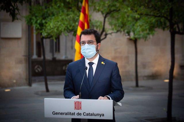 El president de la Generalitat, Pere Aragonès, durante una declaración institucional tras la reunión extraordinaria de la comisión delegada del Govern sobre la pandemia, en el Palau de la Generalitat, a 14 de julio de 2021, en Barcelona, Catalunya (España