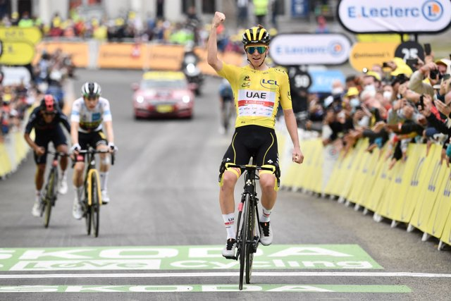 15 July 2021, France, Luz Ardiden: Slovenian cyclist Tadej Pogacar of UAE Team Emirates celebrates after winning the eighteenth stage of the 108th edition of the Tour de France cycling race, 129.7 km from Pau to Luz Ardiden. Photo: Philippe Lopez/AFP/dpa
